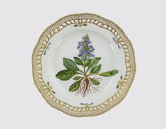 A Royal Copenhagen Flora Danica plate, painted with a large specimen of Ajuga genevensis L. commonly known as blue bugleweed, titled in Latin to the reverse, within a reticulated gilded rim, 25.5cm.