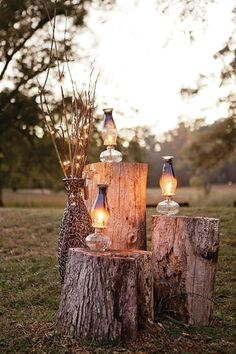 Light up the path to your wedding with lanterns on tree stumps