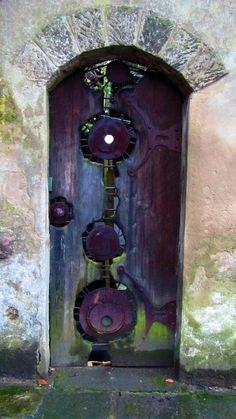 in Wirksworth Quirky circles of metalwork on this purple door in Wirksworth, England.Quirky circles of metalwork on this purple door in Wirksworth, England. Cool Doors, The Doors, Unique Doors, Entrance Doors, Doorway, Windows And Doors, Garden Entrance, Portal, Knobs And Knockers