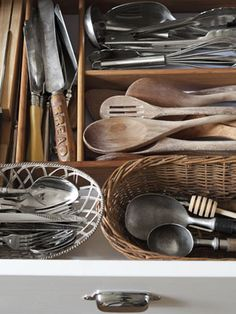 """Stashed in Styleven Trina's kitchen drawers spare no detail, with dividers and baskets organizing utensils. """"I definitely live by that William Morris quote about only owning things you know to be useful, or believe to be beautiful—right down to my kitchen drawers,"""" she says. """"Every time I get a spoon for my morning oatmeal, I love seeing the collection of antique pieces I've purchased mixed with my old corkscrew and my grandmother's silver plate. It really adds to my quality of life."""""""
