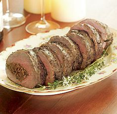 Beef Tenderloin with Wild Mushroom Stuffing  Port Wine Sauce  Every year I make one of these on Christmas Eve the family loves it!
