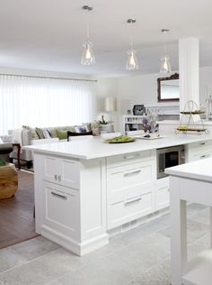 Beautiful kitchen features white cabinets paired with taj for Bruce kitchen cabinets