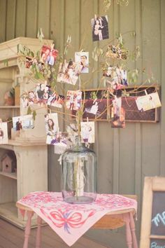 A dead tree branch for pictures, a large jar, glue gun and clothes pins