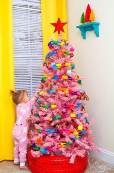 colorful christmas tree Want to decorate your little ones room for the Christmas season the easy way Check out these super fun, colorful, safe and kid-friendly Christmas tree options that your toddler will absolutely love! Retro Christmas Tree, Retro Christmas Decorations, Christmas Trees For Kids, Toddler Christmas, Christmas Time, Christmas Crafts, Christmas Door, Christmas Mantles, Christmas Villages