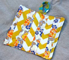 Scrappy Potholder. I love little scrappy bits to make into usefulcute. I always need potholders and handle holders and such!