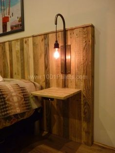 Light and night stand mounted to pallet headboard.. LOVE.
