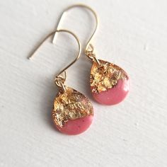 hot pink and gold teardrop earrings on gold by tinygalaxies