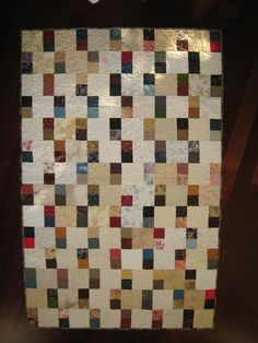 """comfort quilt using up 2 1/2"""" squares and 5"""" neutral squares"""