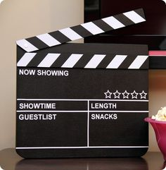 Chalkboard Movie Sign, cute.  This would be fun to make for our movie nights...