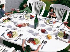 Le dîner de Gulliver by Lilian Bourgeat. It is a super-sized dinner party where the table, chairs and even wine glasses are disproportionally large compared to the diners. They are two-and-a-half times bigger than the regular size.