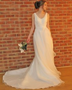 Gorgeous organza silk bridal gown with scoop neckline and medium length train