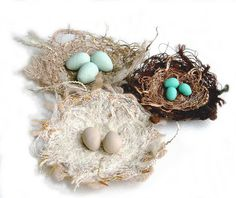 Fibre nests made with threads, yarns and twine. Sewn together in a sandwich of soluble materials. Polymer clay for the eggs.  3 to 4 inches across.  kirstensfabricart.blogspot.com/  www.chursinoff.com/kirsten