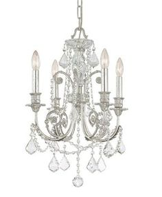 Complete your nursery or kid's room with this silver chandelier from Crystorama's Regis Collection. Adorned with clear hand cut crystals, this intricate chandelier features delicate detailing