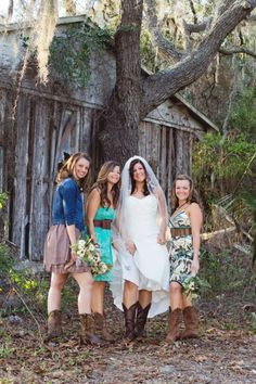 Bridesmaids in mixmatched dresses and cowgirl boots.