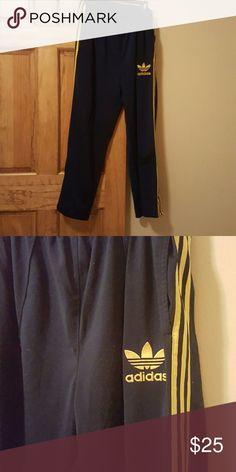 Adidas lounge pants Navy blue/yellow stripes Adidas Pants Track Pants & Joggers