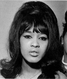 the ultimate 60's hair. height, bangs, flip, she has it all.