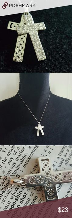 JUST ARRIVED: .925,  Sapphire cross necklace This gorgeous hand made double cross pendant is crafted in solid. 925 sterling silver and layered with 18kt white gold for durability. The pendant contains 0.39 ctw man made sparkling white Sapphire with an 18 inch shiny .925 sterling silver chain. Total weight for this cross pendant is 6.16 grams. Glamouresq Jewelry Necklaces