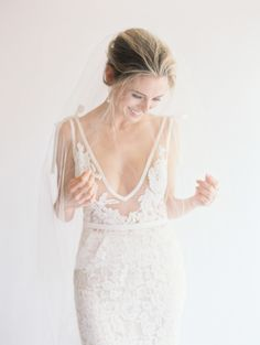 Barely-there illusion and lots of lace: http://www.stylemepretty.com/2016/02/19/the-coolest-dress-necklines-youve-ever-seen/