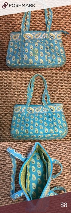 "Sky Blue Vera Bradley Hand Bag For sale is a sky blue with light green paisley patterned  Vera Bradley shoulder bag. The bag is monogrammed with the initials ""SGS"" in light green on front pocket but can't be seen well from a distance. The outside of the purse has an open pocket on the front and inside features 6 individual pockets. Bag is zip closure with 2 straps. It's in beautiful condition but the price reflects the monogramming on the front. Dimensions 9"" x 14"" Vera Bradley Bags Shoulder…"