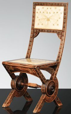 CARLO BUGATTI side chair, painted vellum, fruitwood, metal; back panel painted with a foreshortened dragonfly, c. 1902, 37-3/4 in high  |  SOLD $24,300 Sotheby's Paris, Nov. 27, 2012
