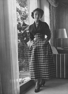 1948, A young Elizabeth Taylor poses demurely. Photo: Condé Nast Archive   Read more: http://www.wmagazine.com/celebrities/archive/elizabeth-taylor-fashion-ss#ixzz2PIrJagK3