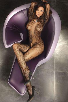 Beautiful Brunette Relaxing Wearing A Body Stocking