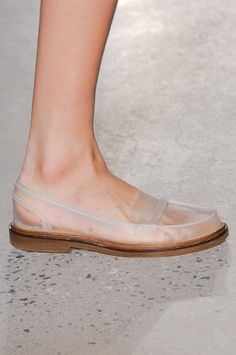 These are so unusual but I kind of like them - these clear loafers would certainly go with anything :-)