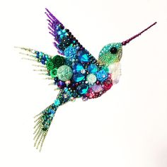 Humming bird mixed media art / buttons recycled jewellery rhinestones https://m.facebook.com/alwayssparkle16/