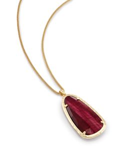($85) Shop gold long pendant necklaces at Kendra Scott. With a bold garnet stone framed in a facted detail on a metallic chain - the Saylor is a must-have accessory.