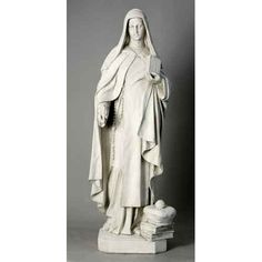 Large Saint Teresa Statue - This large statue of St. Teresa the beautiful depiction of this Catholic saint that lived during the time of the Reformation. Shown here holding her Bible. The statue is made from durable fiberglass and is lightweight and easily move from place to place. Designed for indoor and outdoor use with several finish options.