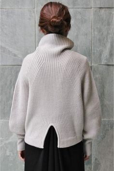 fully fashioned traveling half cardigan stitch souchy cowl neck with back slit detail