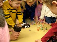 """Three Little Pigs activity - literature connection. Build """"houses"""" out of different materials and see if """"The Big Bad Wolf"""" hair dryer can blow them down. Early engineering education."""