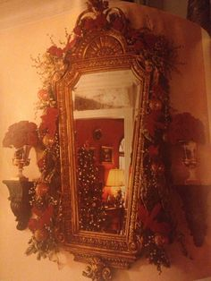 Mirror and sconces decorated for Christmas