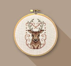SDN001 Stag  Stitched area measures approx. 2 1/2 x 2 3/4 or 6.35 x 7cm when worked on 14 count aida.  Ideal for a small embroidery hoop or greetings card, this vintage inspired stag is bang on trend and can be sewn for any occasion.  Sew De Novo fuses traditional cross stitch themes with a dash of contemporary style to produce modern cross stitch designs for your home or to give as thoughtful gifts.  This digital format instant download pdf chart contains: • Illustrated instructions •…