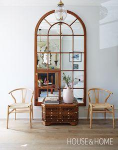 Arched Mirror   Designer Silvana D'Addazio   Photographer: Michael Graydon   #mirror #hallway #wishbonechairs