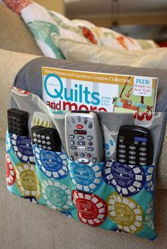 Remote Control and magazine holder for couch.Ask Ken if he wants this instead of. Remote Control and magazine holder for couch.Ask Ken if he wants this instead of keeping the remote Remote Control Organizer, Remote Caddy, Remote Control Holder, Diy Lace Trim, Chair Pockets, Bedside Caddy, Magazine Holders, Purse Organization, Sewing Projects For Beginners