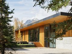 On both sides of the Riverbend residence, echoed in the guest house, ten-foot overhangs run the length of the building. The resulting carved-out spaces, lined with cedar, provide warmth and a natural element, as well as contrast against the metal skin of the building. Residential architecture by CLB in Jackson, Wyoming – Bozeman, Montana. #architecture #design #residence #mountainhome #mountainmodern Architecture Résidentielle, 2 Storey House, Relaxation Room, Mountain Modern, Two Story Homes, Outdoor Living, Outdoor Decor, Maine House, House 2
