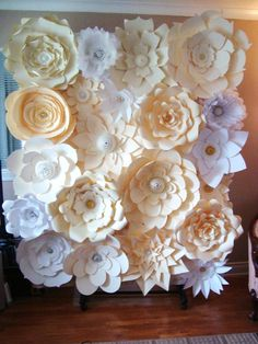 DIY #Paperflowerbackdrop. Ivory, Cream and White #paperflowers with gold, silver, and pearl accents in the centres. $300