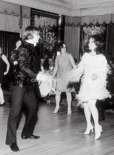 Rudolph Nureyev gets funky doing the twist with Elizabeth Taylor at party circa 1960