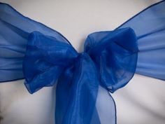 Chair Rentals- Royal Blue Organza Chair Sash. Complete the look with a matching table runner or napkin. Check out our other fabrics at Eventrentalutah.com or follow our board on Pinterest