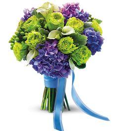 Green garden roses, purple hydrangea and mini white callas make up this bright green and purple bouquet.