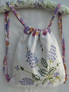 Drawstring backpack made from recycled embroidered linen tablecloth & lined with vintage sheet.