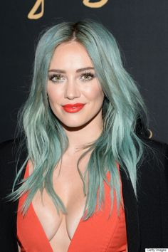 "Hilary Duff made a bold statement at the premiere for her new show ""Younger"" with an aqua hairstyle, white eyeliner and fire engine red lipstick."