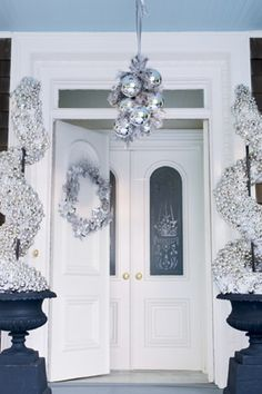 strung together plastic holiday balls and softened the arrangement with silver faux foliage.