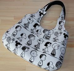 charlie brown snoopy different cartoon caracters prints purse -pic only