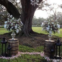Mrs. Vintage   Whiskey barrel altar w/ lanterns and gorgeous florals www.mrsvintagerentals.com