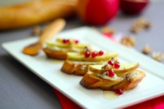 http://whatjewwannaeat.com/apples-honey-and-goat-cheese-crostini/  INGREDIENTS 1 baguette, sliced into ½ inch pieces Olive oil Kosher salt Coast black pepper 1 clove garlic 6 ounces goat cheese 1 teaspoon red chili pepper flakes 1-2 apples  walnuts, diced Honey