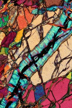 Coming from more than 300 km in the subsurface peridotite of Alpe Arami (Switzerland) is the deepest source rock found in the Alps. It consists of olivine crystals, here crossed by a diagonal vein of serpentine by the color blue.