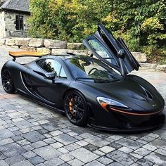 Black McLaren P1 with orange accents!⚫ Via @vistale! I think this color looks great. Do you agree? --- Photo by @ali_autobathelite instagram.com/themanliness_official