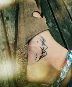 Unique mountain watercolor tattoo on foot for girls